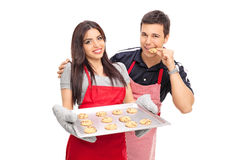 Man tasting the cookies baked by his girlfriend Royalty Free Stock Images