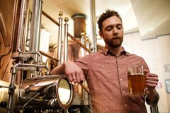 Man tasting fresh beer in a brewery.  royalty free stock photos