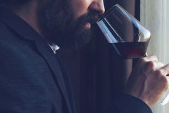 Man tasting a glass of red wine Stock Photography