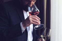 Man tasting a glass of rose wine Royalty Free Stock Photos
