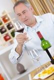 Man tasting red wine. Man royalty free stock images