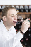 Man tasting a red wine glass Stock Photography