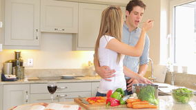Man tasting what woman is cooking Royalty Free Stock Image