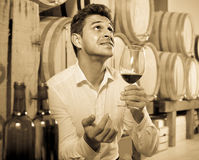 Man tasting wine in cellar Stock Photos