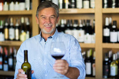 Man tasting wine. Man with a glass of red wine royalty free stock photos