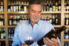 Man tasting wine. Man with a glass of red wine stock images