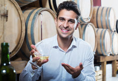 Man tasting wine in store Royalty Free Stock Photo