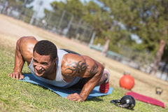Man with Tatoo Doing Push Ups Stock Photos