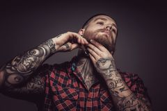 Man with tattoes and beard. Holding safety razor. Isolated on grey background Stock Photos