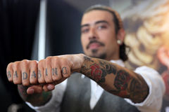 Man with tattoo on fingers Stock Images