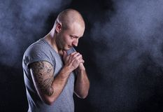 Man with tattoo. Handsome young man with tattoo, isolated on black Royalty Free Stock Image