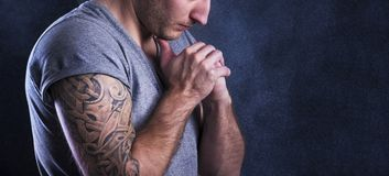 Man with tattoo. Handsome young man with tattoo, isolated on black royalty free stock photo