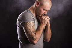 Man with tattoo. Handsome young man with tattoo, isolated on black royalty free stock images