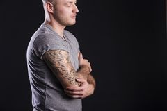 Man with tattoo. Handsome young man with tattoo, isolated on black stock photos