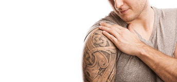 Man with tattoo. Handsome young man with tattoo, isolated on white Royalty Free Stock Images