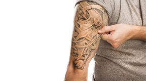 Man with tattoo. Handsome young man with tattoo, isolated on white Stock Photography