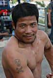 Man with tattoo poses on the Mekong, Chiang Khong, Thailand Stock Photo
