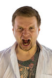 Man with tattooes screaming Royalty Free Stock Image