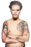 Man with tattoos. And piercing over white background Stock Image