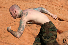 Man with tattoos. Male model with tattoos on his body Stock Photo