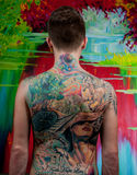 Man with tattoos. Man with a big tattoo on her back Royalty Free Stock Image
