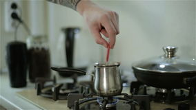 A man with tattoos stirring coffee using a spoon . A man with tattoos stirring coffee in a pot using a tablespoon stock footage