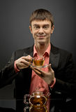 Man with tea Stock Photo