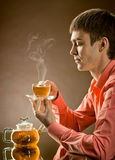 Man with tea Stock Images