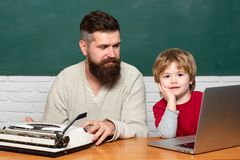 Man teacher play with preschooler child. Man teaches child. father teaching her son in classroom at school. School. Children. Childhood and parenthood. Young stock photo