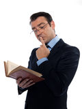 Man teacher reading holding old book thinking Royalty Free Stock Photo