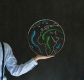 Man with world in the palm of your hand. Man teacher, salesman, student or businessman with chalk world in the palm of your hand stock image