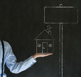 Man with chalk home house or real estate sales sig Stock Images