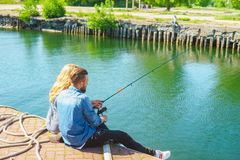 Man teaching his girlfriend to fishing. Date, love and hobby concept. royalty free stock photo