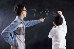 Man teaching math on the boy Royalty Free Stock Photography