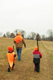 Man teaching sons how to hunt deer Stock Images