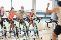 Man teaching spinning class to four people Stock Image