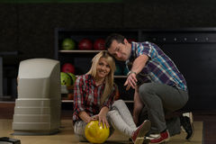 Man Teaching Woman Bowling Royalty Free Stock Image