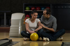Man Teaching Woman Bowling Stock Photo