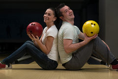 Man Teaching Woman Bowling Stock Photo