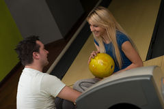 Man Teaching Woman Bowling Stock Images