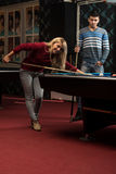 Man Teaching Woman How To Play Pool Royalty Free Stock Images