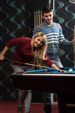 Man Teaching Woman How To Play Pool Royalty Free Stock Photo