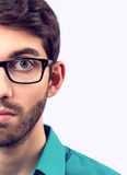 Man in teal shirt with beard and glasses Stock Photo
