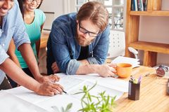 Man and team brainstorming. In startup meeting Royalty Free Stock Photos
