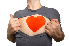 Man tearing apart grey t-shirt. Red heart painted on his chest i. Solated on white background stock image