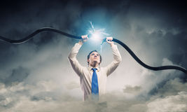 Man tearing cable Royalty Free Stock Photography