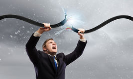 Man tearing cable Royalty Free Stock Images
