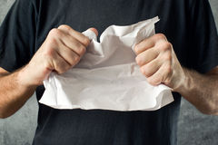 Man tearing contract paper Stock Photography