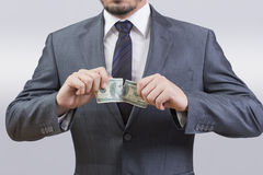 Man tearing dollar Royalty Free Stock Photos
