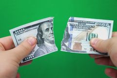 Man tearing dollars on green background royalty free stock photos